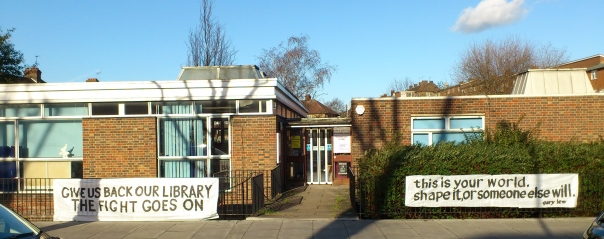 "banners hung outside Preston Library read: ""Give us back our library. The fight goes on"" and ""This is your world. Shape it, or someone else will"""