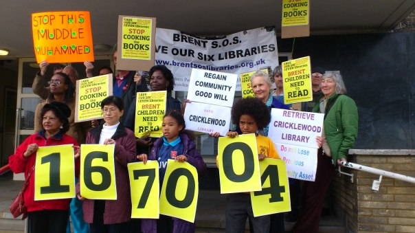 Brent SOS LIbrary campaigners hold placards outside Brent Town Hall